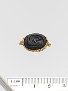 Obsidian seal set in a gold ring
