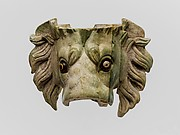 Bone lion's head protome with glass eyes