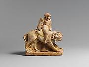 Terracotta statuette of Eros on a lion