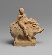 Terracotta statuette of Eros on a boar