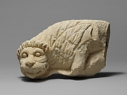 Limestone statue of a lion