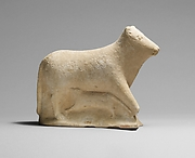 Limestone votive statuette of a cow and calf