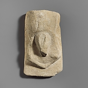 Stone votive relief of male genitalia