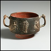 Terracotta cup with appliqués