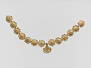Gilt terracotta ornaments from a necklace