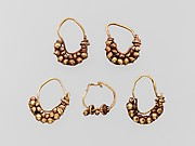 Five gold earrings with spherical elements