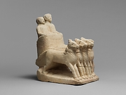 Limestone votive chariot with four horses and two figures