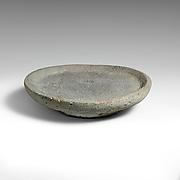 Vesicular basalt mortar or plate