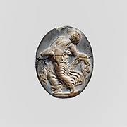 Cameo glass medallion of a maenad