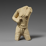 Torso of a limestone fighting woman
