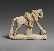 Limestone horse with a rider hunting a lion