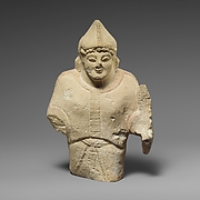 Limestone statuette of a warrior holding a shield