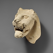 Limestone head of a lion from a votive stele (?)
