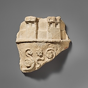 Fragment of a limestone crown belonging to a statue of the Great Goddess