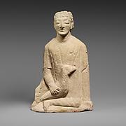 Limestone statuette of a temple boy