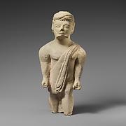Limestone statuette of a bearded male votary in Greek dress