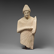 Limestone statuette of a female lyre player