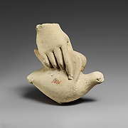 Limestone hand holding a dove