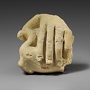 Limestone hand holding a bird
