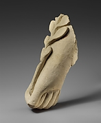 Limestone hand holding a branch of leaves
