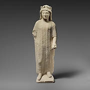 Limestone statuette of a boy