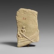 Fragment of a limestone votive relief with a boat