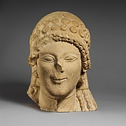 Limestone head of a female votary