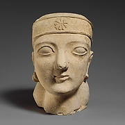 Limestone head of a beardless male with a diadem