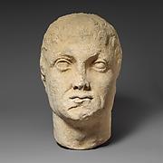 Limestone head of a beardless male votary