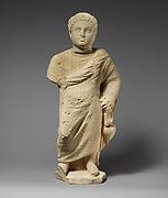 Limestone statuette of a boy holding an amphora