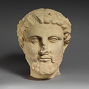 Limestone bearded head with a wreath of leaves