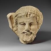 Limestone head of a bearded man from a funerary stele