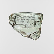 Glass fragment with later inscription