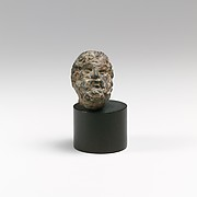 Bronze head of a bearded man or god