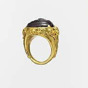 Gold ring with a carnelian or glass intaglio