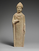 Limestone statuette of a female votary holding a flower