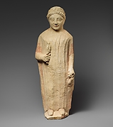 Limestone statuette of a boy holding a bird and a branch of leaves
