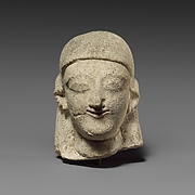 Limestone head of a female with a plain headdress