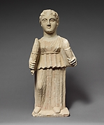 Limestone statuette of Artemis (?) holding two torches