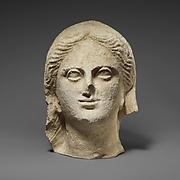 Limestone head of a veiled female votary