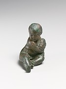 Bronze statuette of a child with a bunch of grapes