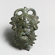 Bronze situla (pail) attachment in the form of a Silenos head