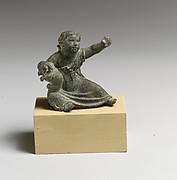 Bronze statuette of a girl holding a dog