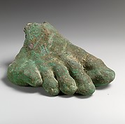 Bronze toes and instep of an over-lifesized right foot