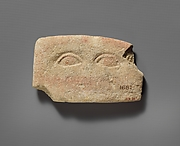 Limestone plaque with two eyes