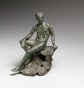 Bronze statuette of Hermes seated on a rock