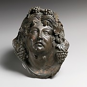 Bronze attachment in the form of the head of Pan