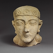 Limestone head of a beardless male with a diadem