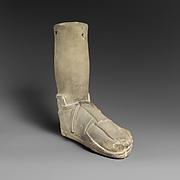 Limestone votive (?) foot with a sandal