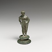 Bronze statuette of a draped youth